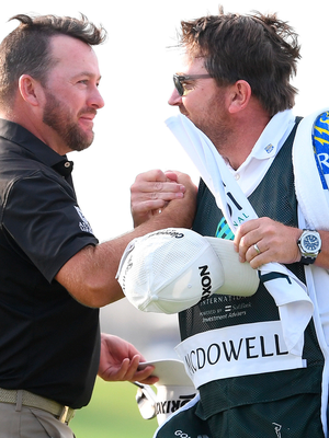 McDowell celebrates with his caddie. Photo: Getty Images