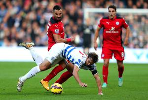 Queens Park Rangers midfielder Niko Kranjcar is upended by a challenge from Leicester City's Marcin Wasilewski during their Premier League clash at Loftus Road. Photo: Ben Hoskins/Getty Images