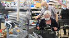 Customers shop in ALDI in Duesseldorf, Germany, as the virus continues to spread. Photo: REUTERS/Wolfgang Rattay