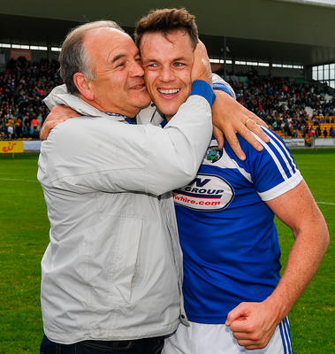 Laois' John O'Loughlin is congratulated by his dad, Oliver, after beating Westmeath