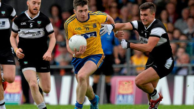 Roscommon's Cathal Cregg brushes off a challenge from Keelan Cawley and Niall Murphy