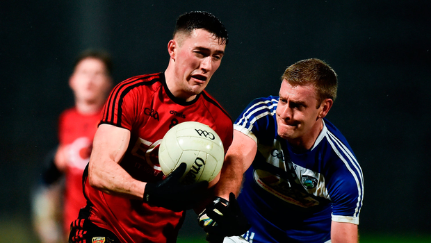 Conor Francis of Down in action against Donie Kingston of Laois. Photo by Oliver McVeigh/Sportsfile