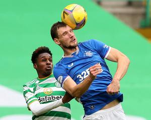 Rangers' Borna Barisic rises for the ball with Celtic's Jeremie Frimpong. Photo: Reuters