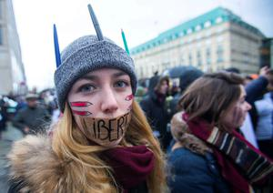 A woman tapes her mouth displaying the word Freedom during a rally in Berlin recently to support freedom of speech after the Charlie Hebdo attacks