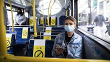Passenger Luana Piovesan wearing a mask on the bus. Picture by Fergal Phillips