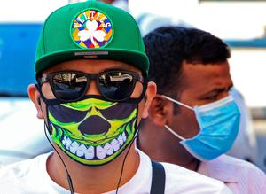 Fears: People wearing protective masks on a street in Kuwait City. Photo: getty images