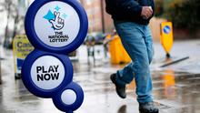 National Lottery sign outside a newsagent in north London Credit: Yui Mok/PA Wire