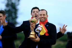 Europe's Sergio Garcia (front) and Rory McIlroy pose with The Ryder Cup on day three of the 40th Ryder Cup at Gleneagles