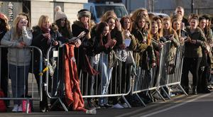 One Direction fans wait for Louis Tomlinson to arrive at the Keepmoat Stadium, Doncaster where he was making his debut for the reserves