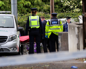 Bodies are removed from the scene. Photo: STEVE HUMPHREYS