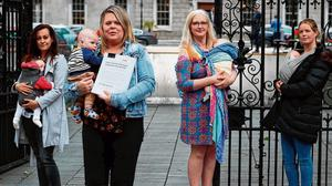 Taking a stand: Mothers (from left) Andrea Simic, Tara MacDarby, Paula Solan, Amy McGivney, and their babies, at Leinster House where they presented a petition calling for an extension of maternity leave for three months due to the Covid-19 crisis. Photo: Brian Lawless/PA Wire