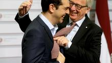European Commission President Jean-Claude Juncker (R) greets Greece's Prime Minister Alexis Tsipras before the Eastern Partnership Summit session in Riga, Latvia. Photo: Reuters