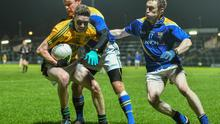 Meath's Ruairi O'Dowd holds the ball up under pressure from Longford's Enda Williams, left, and Brendan Devine.