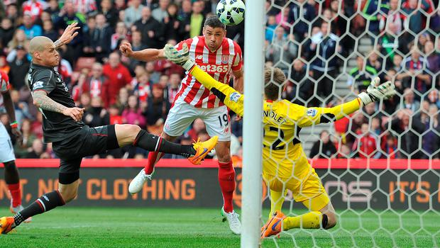 Jon Walters scores for Stoke during their 6-1 win against Liverpool which has increased the pressure on manager Brendan Rodgers