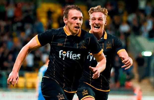 David McMillan, left, of Dundalk celebrates after scoring his side's second goal with team-mate John Mountney during the UEFA Champions League Third Qualifying Round 2nd Leg match between Dundalk and BATE Borisov at Tallaght Stadium in Tallaght, Co. Dublin. Photo by David Maher/Sportsfile