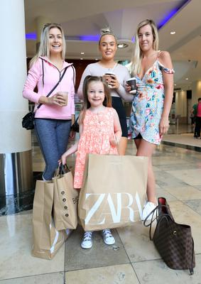 Five year old Larragh Lawlor fron Firhouse pictured at Dundrum shopping center with her mum Naoise [on right], Kate Blanche, Firhouse  and Orlagh Carty, from Dundrum after Dundrum Shopping Center reopened its doors to shoppers. Picture Credit: Frank McGrath