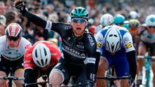 Ireland's Sam Bennett celebrates as he crosses the finish line to win the third stage of the Paris Nice cycling race. Photo: Laurent Cipriani/AP