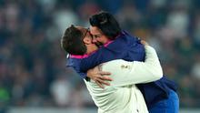 YOKOHAMA, JAPAN - NOVEMBER 02:  South Africa coach Rassie Earsmus celebrates with his wife after the Rugby World Cup 2019 Final between England and South Africa at International Stadium Yokohama on November 02, 2019 in Yokohama, Kanagawa, Japan. (Photo by Stu Forster/Getty Images)