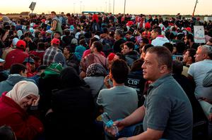 Migrants wait in a holding area just metres across the Croatian after walking the last few kilometres from Serbia to Croatia on September 21, 2015 in Sid, Serbia. Thousands of migrants have arrived in Austria over the weekend with more en-route from Hungary, Croatia and Slovenia. Politicians across the European Union are to hold meetings on the refugee crisis with EU interior ministers meeting tomorrow and EU leaders attending an extraordinary summit on September 23.  (Photo by David Ramos/Getty Images)