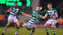Jack Byrne, centre, of Shamrock Rovers celebrates after scoring his side's third goal with team-mates Liam Scales, right, and Roberto Lopes during the SSE Airtricity League Premier Division win over Dundalk at Tallaght Stadium. Photo: Ben McShane/Sportsfile