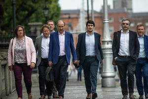 'Reservoir Dogs' march up Merrion Street: Fianna Fáil leader Micheál Martin arriving at Government Buildings with his negotiating team to sign off on the draft agreement. Photo: Mark Condren