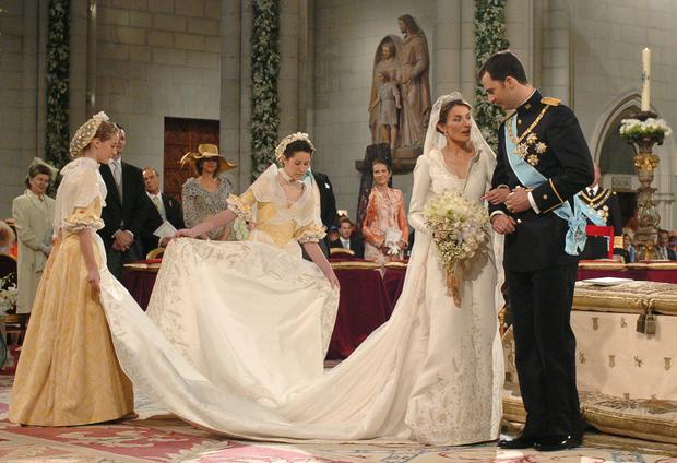Spain's Crown Prince Felipe de Bourbon stands next to his bride Letizia Ortiz as they marry in Almudena cathedral May 22, 2004 in Madrid.  (Photo by Manuel H. de Leon /Pool/Getty Images)