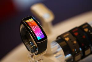 Samsung Gear Fit wristwatchs sit on display at the Mobile World Congress in Barcelona.