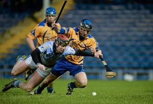 Portumna's Gareth Heagney and Na Piarsaigh's David Dempsey scramble for the ball