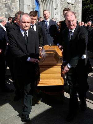 Sean, left and Ciaran Haughey, stand by as the coffin enters St. Sylvester's Parish Church, Malahide at the funeral of his mother, Maureen Haughey. Credit: Damien Eagers
