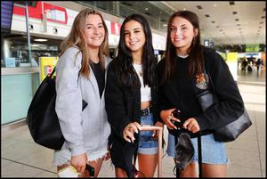Dublin Students Millie Costello, Christina Walsh and Kenzi Ross in an empty Terminal 1 Departures Hall at Dublin Airport on the Bank Holiday Weekend before heading to Portugal on Holiday. Photo by Steve Humphreys