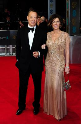 Tom Hanks and wife Rita Wilson arriving at The EE British Academy Film Awards 2014, at the Royal Opera House, Bow Street, London.