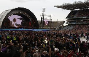 Pope Francis joins an audience of 82,500 at Croke Park Stadium in Dublin during the Festival of Families event, as part of his visit to Ireland. Photo: Brian Lawless/PA Wire