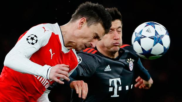 When Laurent Koscielny barged into Robert Lewandowski, the referee gave a penalty and a yellow card, before changing his mind to a red. Photo: Stefan Wermuth/Reuters