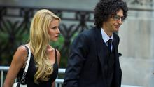Radio host Howard Stern arrives with wife Beth Ostrosky to attend the funeral of comedienne Joan Rivers at Temple Emanu-El in New York September 7, 2014. REUTERS/Lucas Jackson