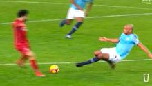 Vincent Kompany flies in for a challenge