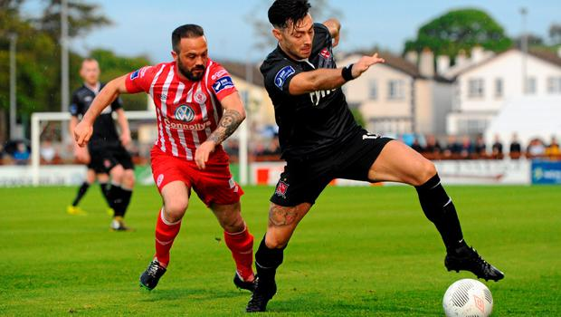 12 June 2015; Richard Towell, Dundalk, left, in action against John Russell, Sligo Rovers. SSE Airtricity League Premier Division, Sligo Rovers v Dundalk, The Showgrounds, Sligo. Picture credit: Seb Daly / SPORTSFILE