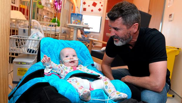 Pictured are Republic of Ireland assistant manager Roy Keane with Santa Ture, age 7 months, from Drogheda, Co. Louth. Temple Street Hospital, Dublin.  Picture credit: David Maher / SPORTSFILE