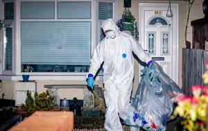 PSNI officers search a house in the Ardoyne area of Belfast where a drug dealer was arrested on suspicion of murdering Robbie Lawlor