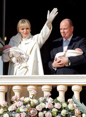 Prince Albert II of Monaco and his wife Princess Charlene hold their twins Prince Jacques and Princess Gabriella as they stand at the Palace Balcony during the official presentation of the Monaco's newborn royals