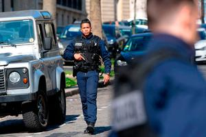French Police officers secure the scene near the Paris offices of the International Monetary Fund (IMF) on March 16, 2017 in Paris, after a letter bomb exploded in the premises.AFP PHOTO / Getty Images