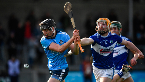 Dublin's Donal Burke is hooked by Pádraig Delaney of Laois during their Allianz NHL clash. Photo by Brendan Moran/Sportsfile