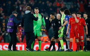 Liverpool manager Juergen Klopp shakes hands with Simon Mignolet after the game