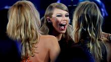 """Taylor Swift reacts as she heads to the stage to accept the award for best female video for """"Blank Space"""" at the 2015 MTV Video Music Awards in Los Angeles, California August 30, 2015.  REUTERS/Mario Anzuoni"""