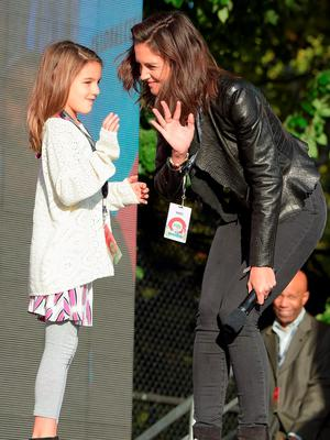 Suri Cruise (L) and actress Katie Holmes speak  on stage at the 2015 Global Citizen Festival to end extreme poverty by 2030 in Central Park on September 26, 2015 in New York City.  (Photo by Theo Wargo/Getty Images for Global Citizen)