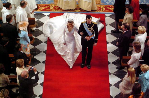 Spain's Crown Prince Felipe de Bourbon walks next to his bride Letizia Ortiz during their wedding ceremony in Almudena cathedral May 22, 2004 in Madrid.  (Photo by Gustavo Cuevas/Pool/Getty Images)