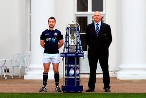 Scotland captain Greig Laidlaw and head coach Vern Cotter pose next to the Six Nations trophy during the RBS 6 Nations Media Launch at The Hurlingham Club, London. Photo: PA