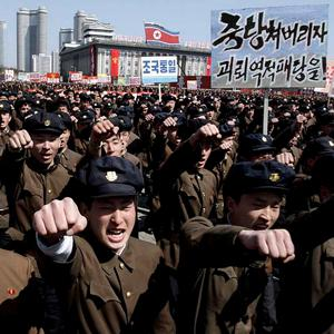 University students punch the air as they march through Kim Il Sung Square in downtown Pyongyang, North Korea.
