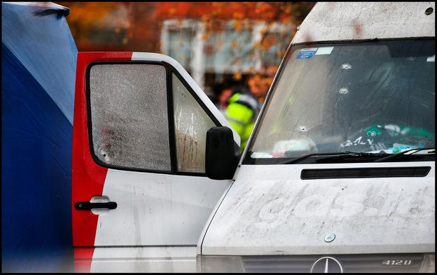 Examination: Bullet holes are seen in the windows of a van pictured at the scene of the fatal shooting in Leixlip, Co Kildare. Photo: Steve humphreys