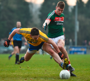 Roscommon's John McManus in action against Mayo's Conor OShea. Photo:  Ramsey Cardy/Sportsfile