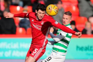 Aberdeen's Scott McKenna and Celtic's Leigh Griffiths battle for the ball. Photo: PA